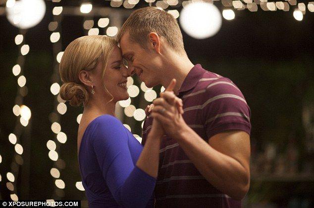 The last dance: Officer Alex Murphy (Joel Kinnaman) enjoys a tender moment with wife Clara (Abbie Cornish) in a new RoboCop film still