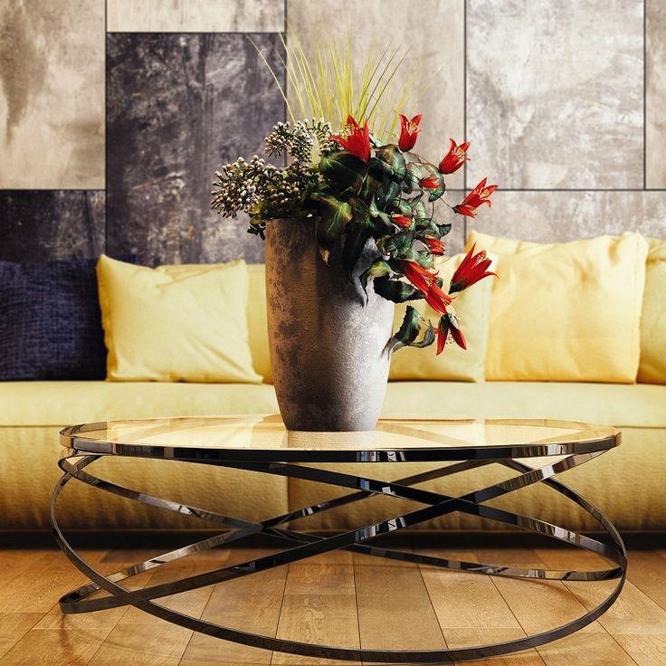 Esempi arredamento soggiorno con un tavolino di vetro e un for Esempi arredamento soggiorno