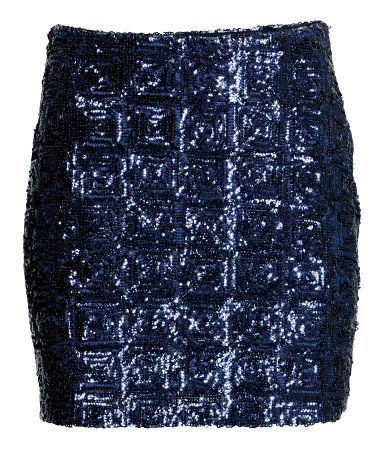 Short skirt in woven fabric with sequined embroidery and a concealed side zip. Lined.