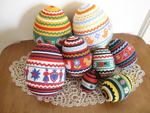 easter eggs decorated with trims and ribbons