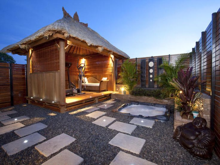 Indoor-outdoor outdoor living design with gazebo & decorative lighting using natural stone - Outdoor Living Photo 465693