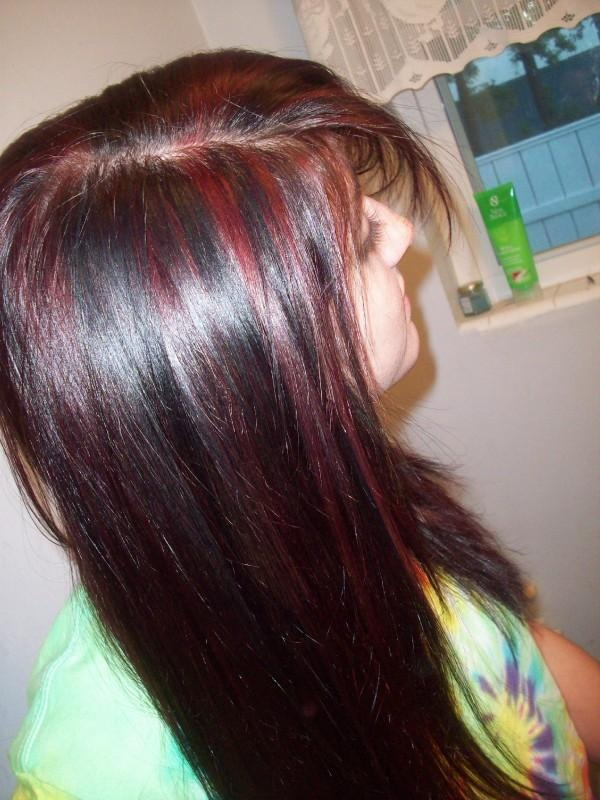 We did a deep red with Black lowlights in Style This by Janna Cook