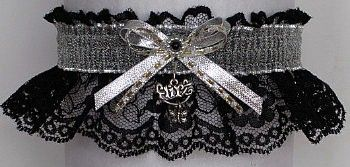 Enticing. 'Flirt' charm with a butterfly attached to this black lace Garter. A SHEER SILVER METALLIC band and double bow finish the look. Silver Metallic Garter for Wedding Bridal Prom Fashion. Visit: www.garters.com/page33d.htm