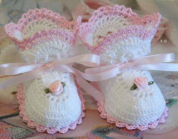 Crochet Open Crescent Baby Booties by mycrochetboutique on Etsy, $7.50  These crochet baby booties are made with white cotton thread. Accented with ribbon roses and matching ribbon. They measure 3 1/2 inches from heel to toe and will fit a 0-3 month baby or reborn doll. Trim can be done in white, pink, lilac, mint, blue, and red upon request.