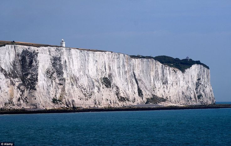 Famous landmark: The White Cliffs of Dover, with a lighthouse on top, seen from the car ferry port.