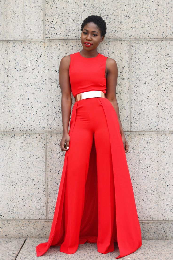 Style Synopsis wears the Warp Jumpsuit in red. Shop online at AQAQ.com