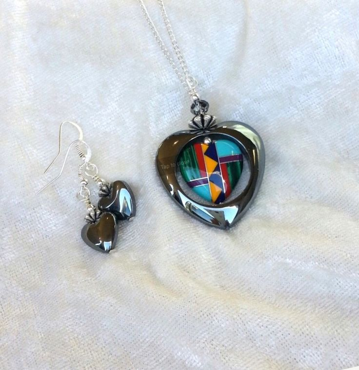 A personal favorite from my Etsy shop https://www.etsy.com/listing/173249228/hematite-and-multi-precious-heart-inlay