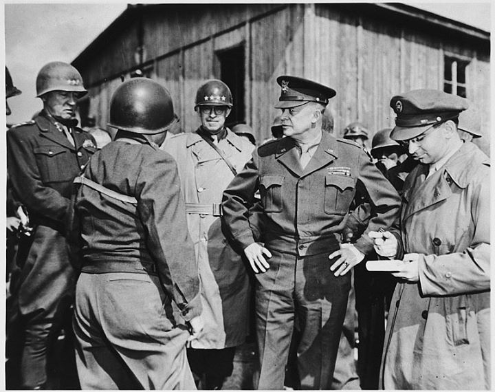 """Generals Dwight D. Eisenhower George Patton Omar Bradley and a correspondent for the U.S. Army newspaper """"Stars and Stripes"""" Jules Grad (at the far right) during an inspection of the newly liberated Ohrdruf concentration camp."""