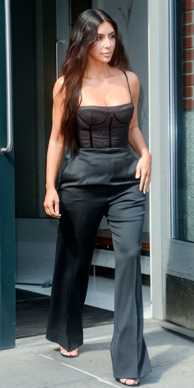 Kim Kardashian West demoed how to use lingerie as a layering piece when she stepped out in New York City wearing a bustier top teamed with high rise trousers. Kardashian West kept it simple, going sans jewelry and opting for just a pair of black strappy sandals.