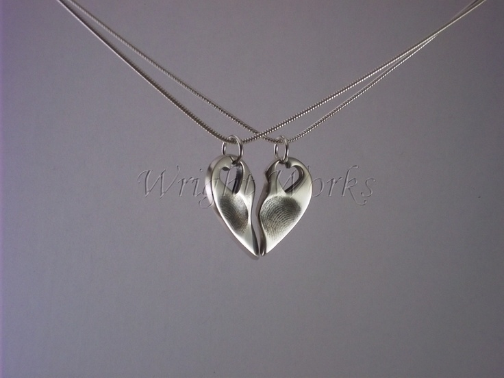 Hearts coming together. Medium pendant with two prints cut in half each person wearing half each. Silver hearts with fingerprints