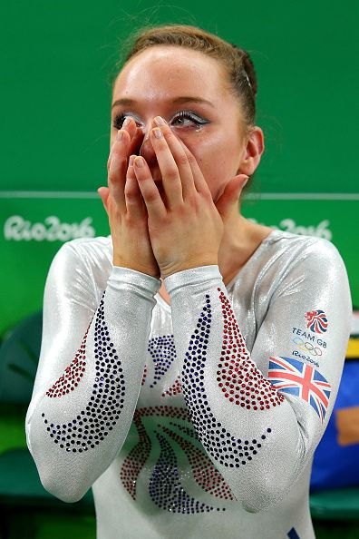 Amy Tinkler of Great Britain celebrates winning the bronze medali after…