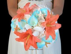 Turquoise tipped calla lilies, seashells and starfish make a beautiful blue and coral wedding bouquet