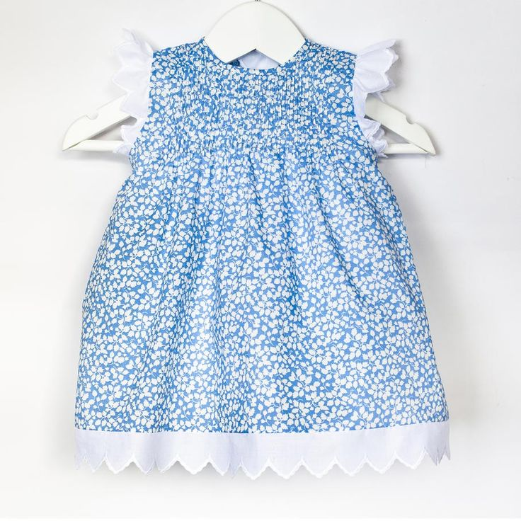 Baby dress in Liberty print with handmade pleats to front. Los Encajeros