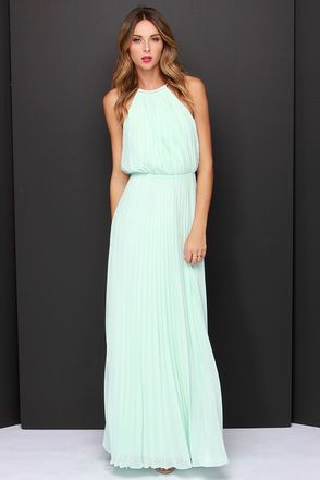 From the first dance to the last, everything will be an utter dream in the Bariano Melissa Mint Maxi Dress! A stretchy gold coil necklace (with adjustable lobster clasp closure) creates a sultry halter neckline supporting pleated mint chiffon. Sleeveless bodice billows into an elastic waistband before descending into an unforgettable maxi length skirt. Triangular back keyhole. Fully lined in mint satin. Self: 100% Polyester. Lining: 97% Polyester, 3% Spandex. Hand Wash Cold. Imported.