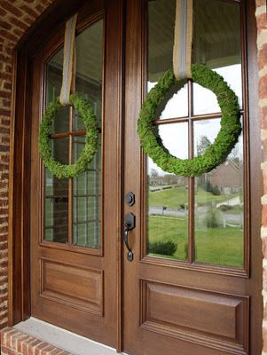 double glass doors with simple green wreaths