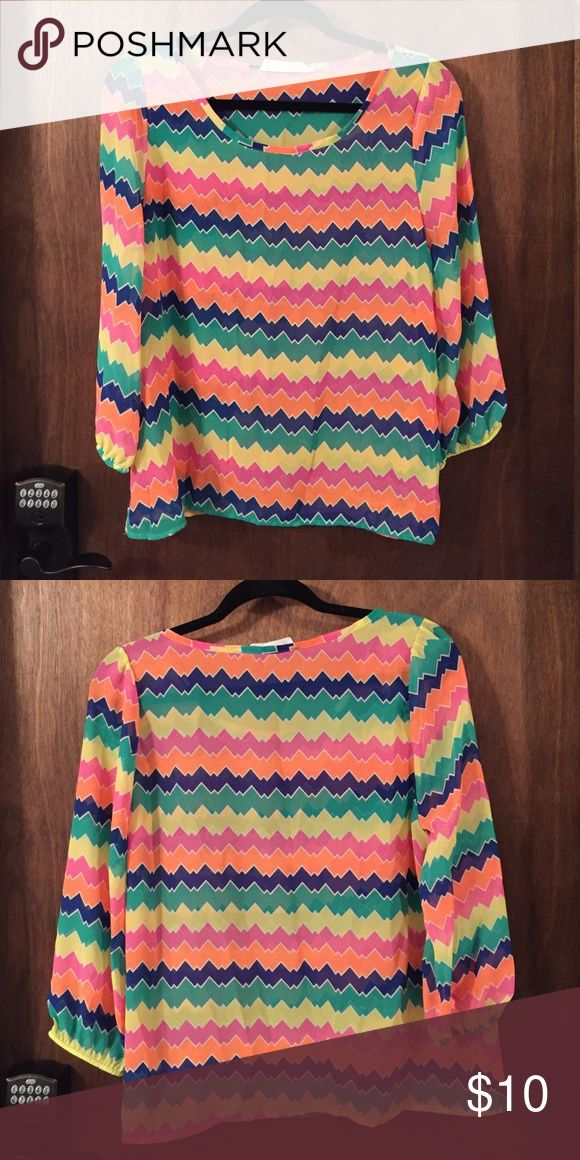 Apricot lane blouse This multicolored blouse is perfect for spring with all of the bright colors. Plus it's sheer enough to flow just perfectly with the wind. apricot lane Tops Blouses