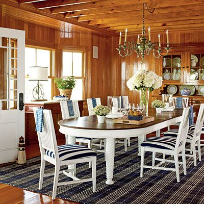 Nautical Nostalgia    Nothing warms a space like wall-to-wall wood paneling. A classic blue-and-while color scheme softens this dining space and keeps the wood from being overwhelming