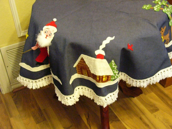 this is seriously cute! a vintage table cloth for Christmas
