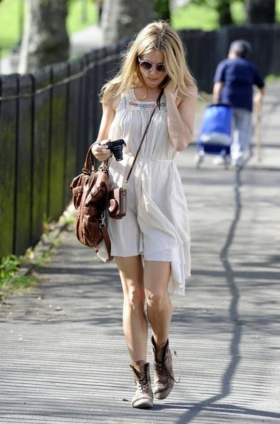 Sienna Miller in Cognac Boots street-style