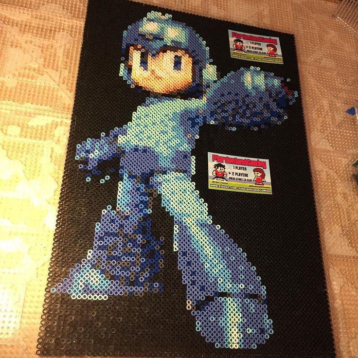 On instagram by tyler_plurden #nes #microhobbit (o) http://ift.tt/1PDabkh amiiboish #megaman :)... Wont mind keeping this one but id let it go for $110 shipped mounted on a 12x18 frame...Gotta give my eyes a break after this one hehe pew pew #igersnintendo #Nintendo #rockman  #bluebomber #nintendolife #ninstagram #gamer #nerd #videogames #nostalgia #perler #pixel #pixelart #8bitart #8bit #edm #kandi #plur #retrocollective #retro #supernintendo #gameboy #3ds #n64 #nintendo64 #snes #capcom…
