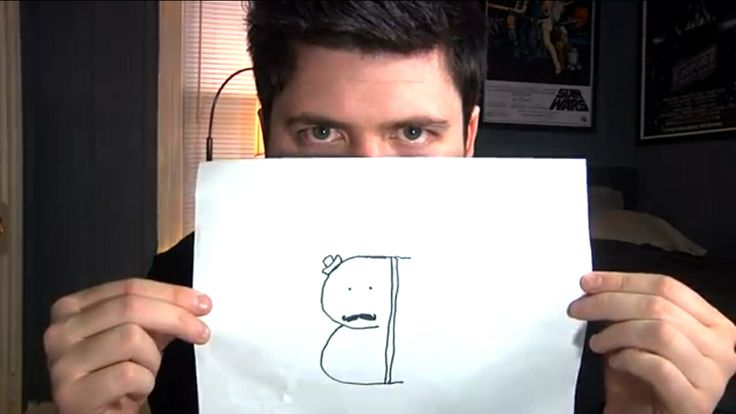 A pair of buttocks with a mustache and tiny hat by Olan Rogers