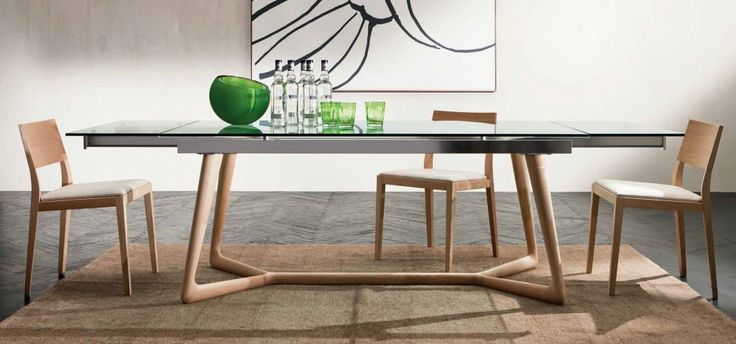 Extendible table in solid wood, available in natural ash, wengè, walnut and laquered open pore. Elegance and nordic design.