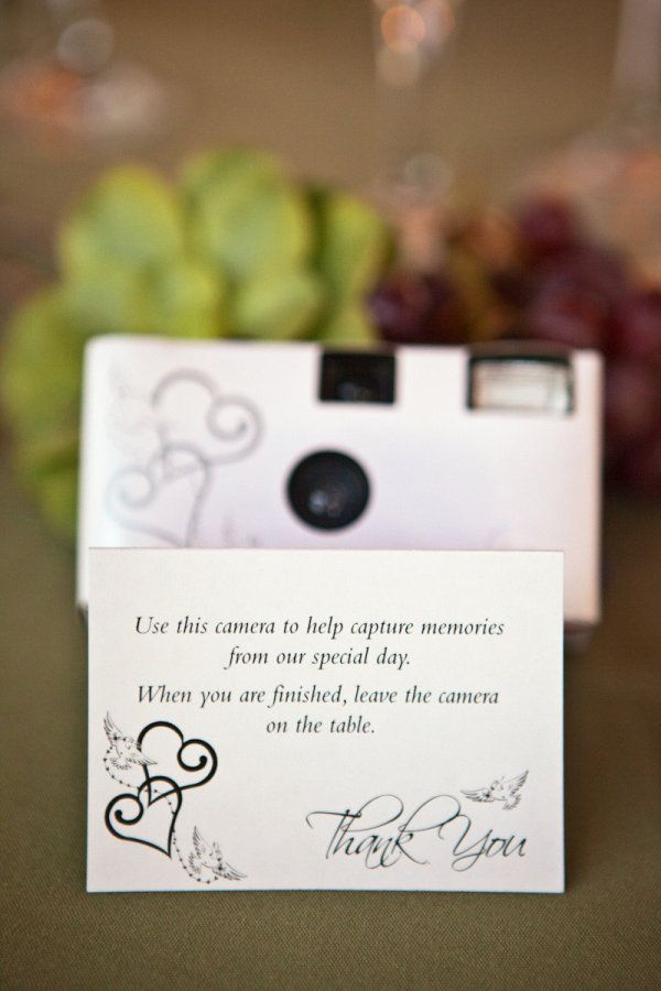 Disposable cameras for guests at each table to capture moments the bride and groom may not see otherwise!