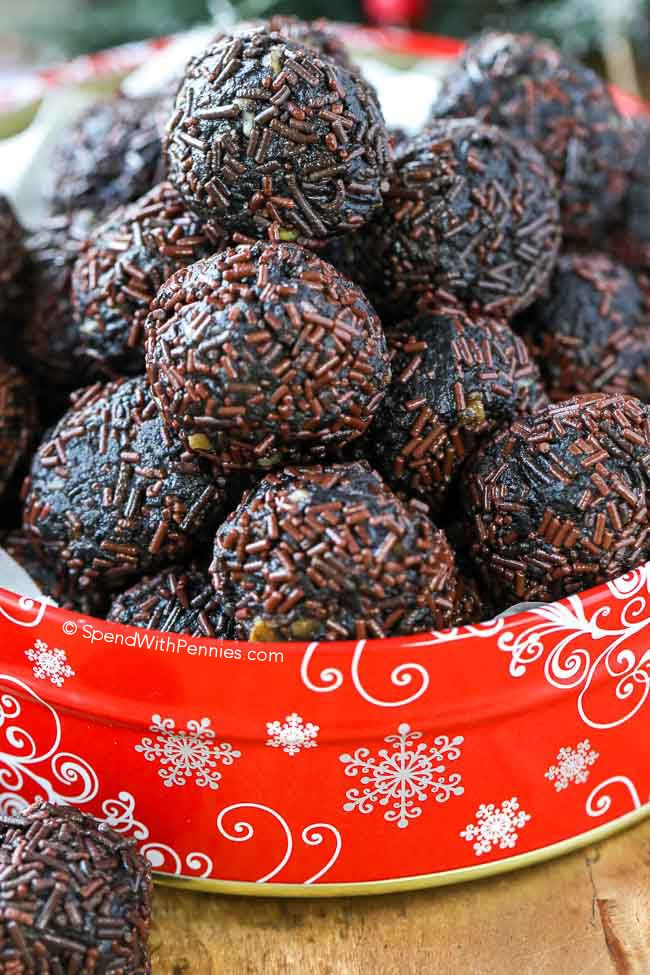 These easy 4 ingredient rum balls are made with Oreo cookies, rum and walnuts for the perfect no bake holiday bite! Roll them in sprinkles or coconut.