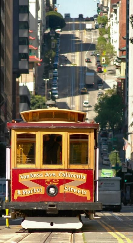 Cool pic of #SanFransisco  I canNOT believe those trolleys go UP that hill behind the one in the photo!!!  HOW?!?!