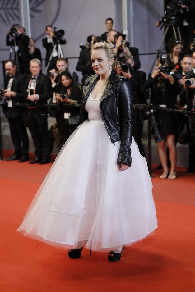 The Best Celebrity Style From Cannes Film Festival 2017: Cannes Film Festival known for princess-like gowns and sexy, thigh-high slits, and this year, there's more of the same—with even more pouf and revealing details. -- Elisabeth Moss in poufy dress and leather jacket  |  coveteur.com