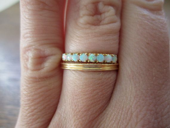 Wedding bands with a bit of opal in them would be perfect because we're both October babies.