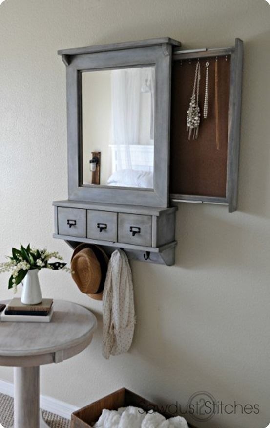 Add a pull-out organizer behind your entryway's mirror to hang jewelry.
