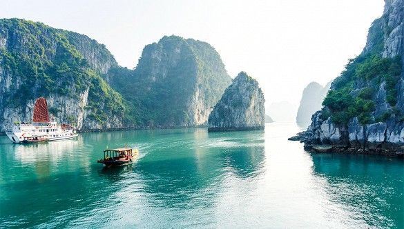Take a cruise in Hạ Long Bay, Vietnam A vision of towering limestone rainforest islands surrounded by emerald-green waters, Hạ Long Bay in the Gulf of Tonkin, Vietnam, includes more than 1,600 islands and islets, mostly uninhabited. The area provides lots of interest for sightseers, scuba divers, rock climbers, and hikers alike.