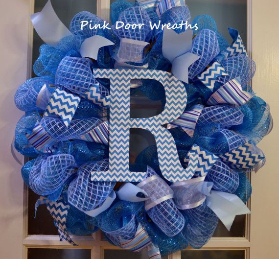 1 mesh MONOGRAM wreath    Made with teal mesh and accented with lots of different color blues to showcase the teal chevron monogram in the