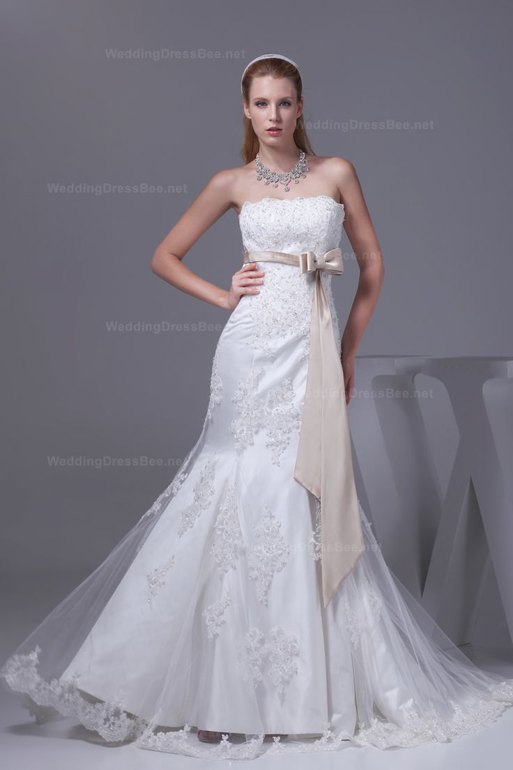 Attractive strapless trumpet style wedding dress with colored sash on the empire waist