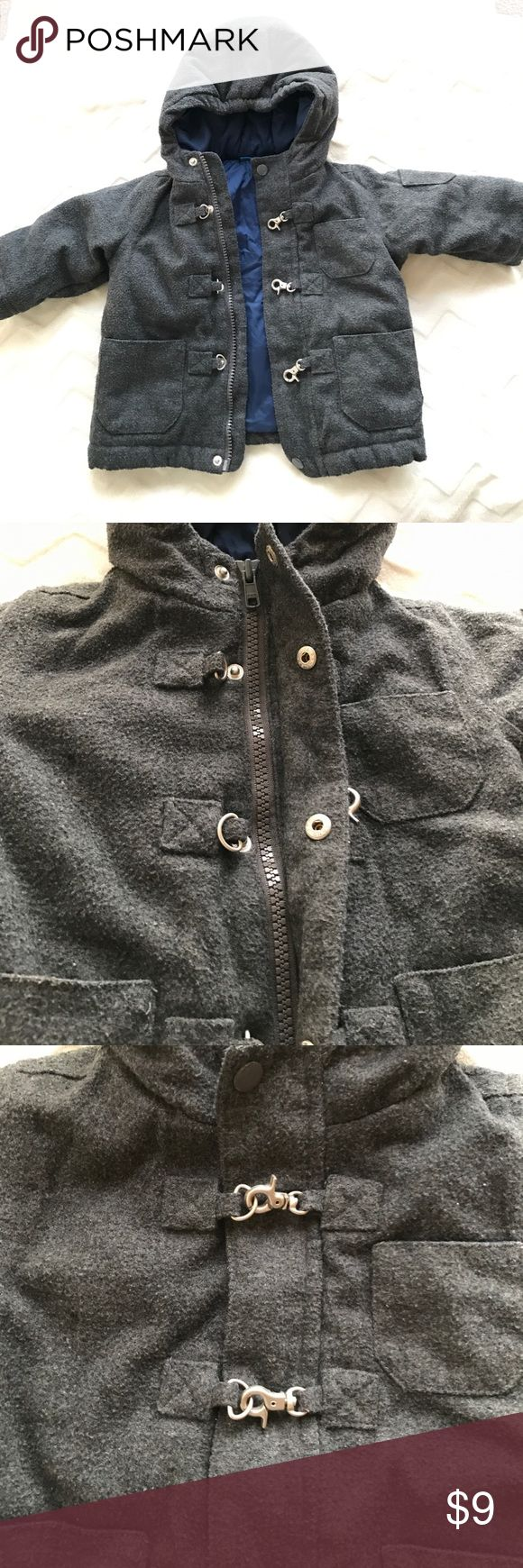 Thick grey zip up, button up & clip jacket Very comfy & warm! I know summers approaching but for those who are excepting a bundle during winter you can save for those cold fall & spring days & nights this jacket is a lifesaver! It's grey with a zipper, button up & then clasps together. Puffer jacket like inside polyester/wool feeling on the outside. Super cute can be for boys or girls. Size 6-9 months runs big. Worn with love in good condition Jackets & Coats Puffers