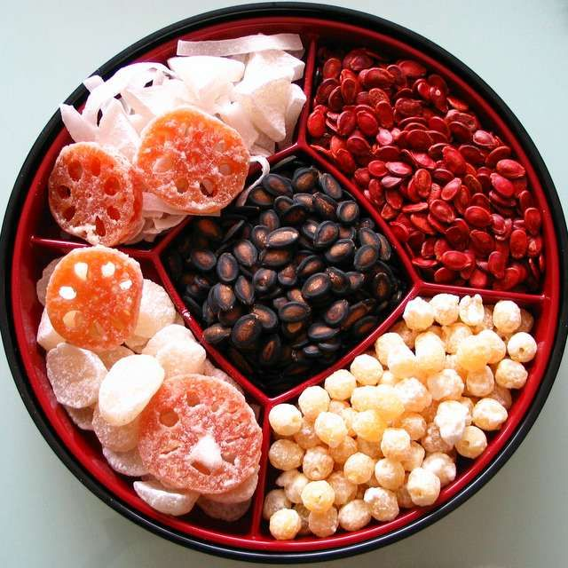 The Tray of Togetherness, also called the prosperity box, contains eight sweet or candied pieces that all represent good fortune