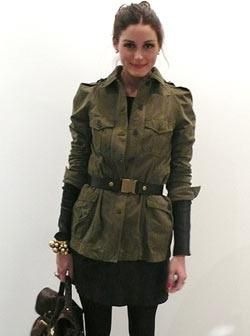 Who made Olivia Palermo's black long sleeve dress, green jacket, brown purse and boots that she wore on Vogue's UK site? Dress – Cos  Jacket – Zara  Belt – Tibi  Purse – Mulberry Alexa  Boots – Ted Baker