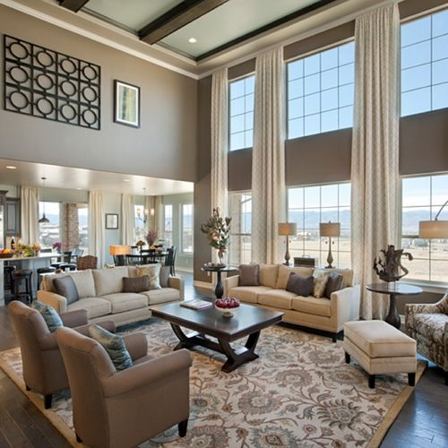 Some transitional track arm sofas and a traditional rug pair nicely in this light filled great room | Toll Brothers at BackCountry, CO