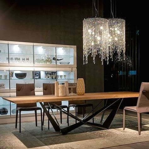 Cattelan Italia Skorpio Wood Table. Not a fan of the chandeliers but love the overall look.