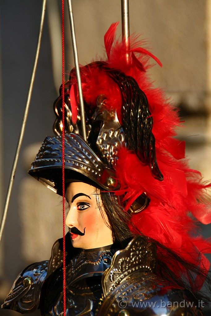 The puppet performance is common in Sicily, and is a tradition stemming from commedia della arte. What makes the shows uniquely Sicilian is their dependence on a single story.