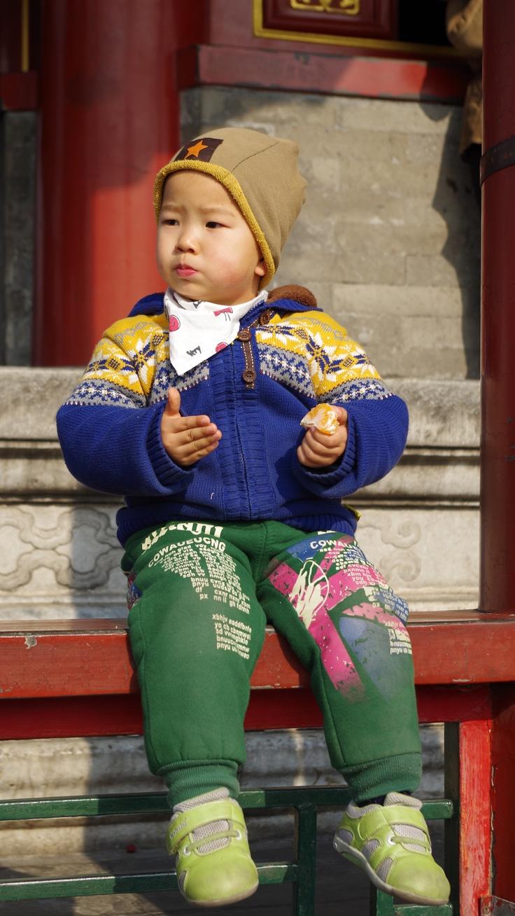 Child with orange. Jingshan Park. Beijing, China. Photo by Kayla Hedman