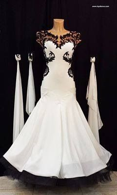White standard dress with black lace and fringe.  Visit http://ballroomguide.com/comp/attire/lady.html for more info about competition attire.