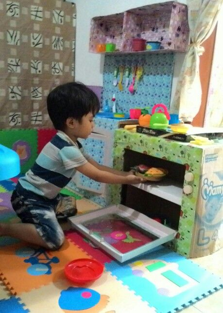 Playing on the #kitchenset made from #cardboard #oven #kids #toy #diy #idea #craft #toddleractivity