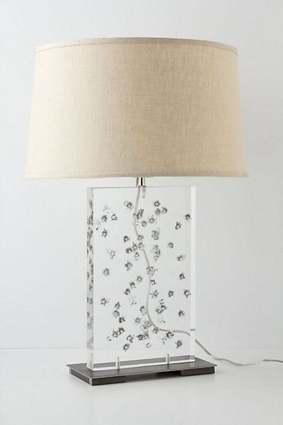 this lamp base is acrylic that has been shot by 50 22-caliber bullets!!!! Ballistics Base #anthropologie