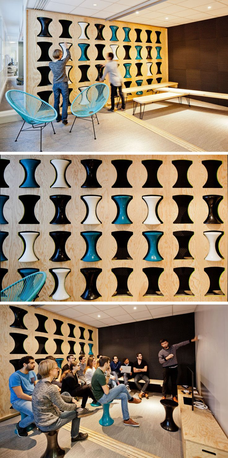This office has an awesome slot wall for storing stools.