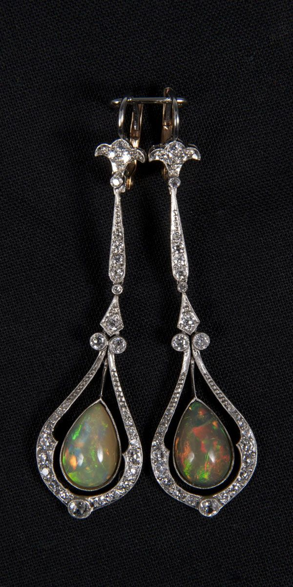 Pair of Edwardian-style opal and diamond pendant earrings, each with a pear-shaped opal drop