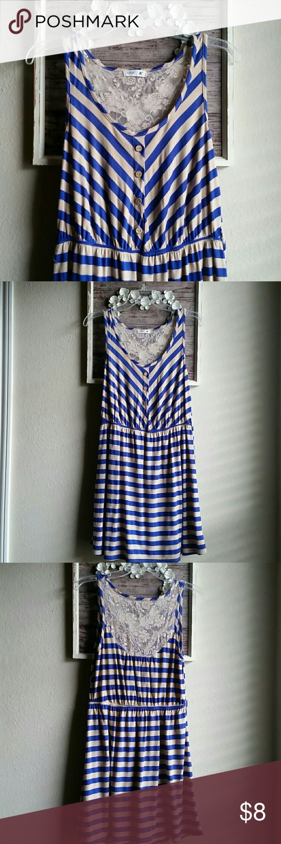 Cute dress Cobalt blue and tan striped. Floral lace back. Faux button front with elastic waist. Some elastic is coming out as shown in pic 4(reflected in price ) . Tags are missing but fits like a juniors large. Perfect for spring and summer Dresses