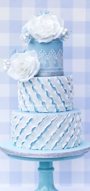 I love the ruffles on the bottom 2 tiers and the roses are flawless!