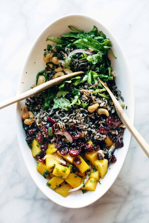 Easy Thanksgiving Salad - arugula, cashews, dried cranberries, red onions, wild rice, and a lemon dressing that shakes up easily in a jar. This recipe is ALWAYS a hit for Thanksgiving! also: conveniently gluten free and vegan. | http://pinchofyum.com